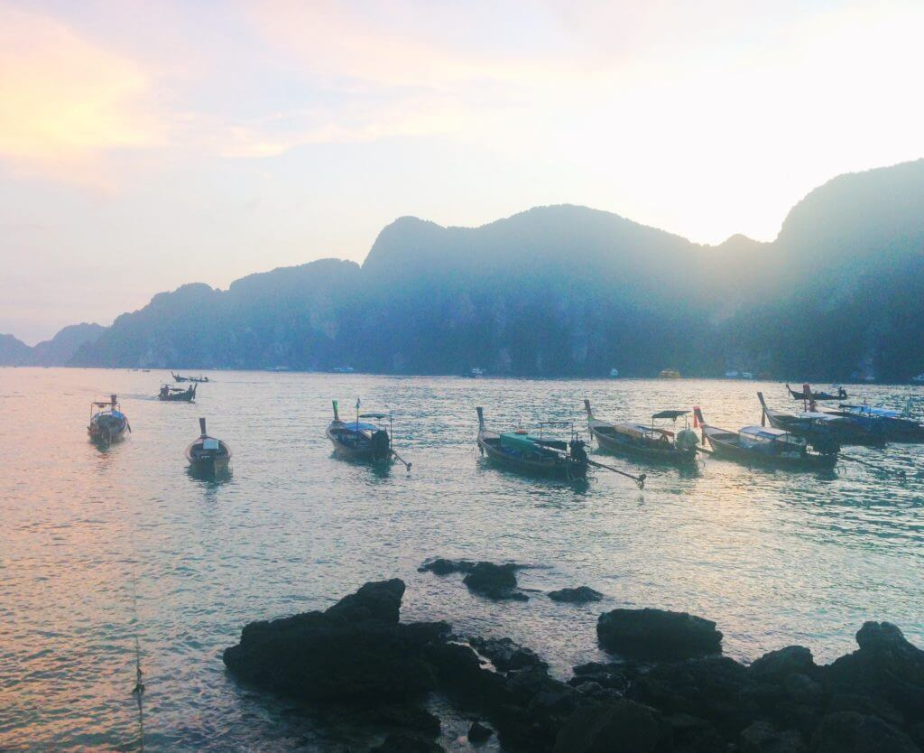 Photo of Koh Phi Phi beach with boats Thailand