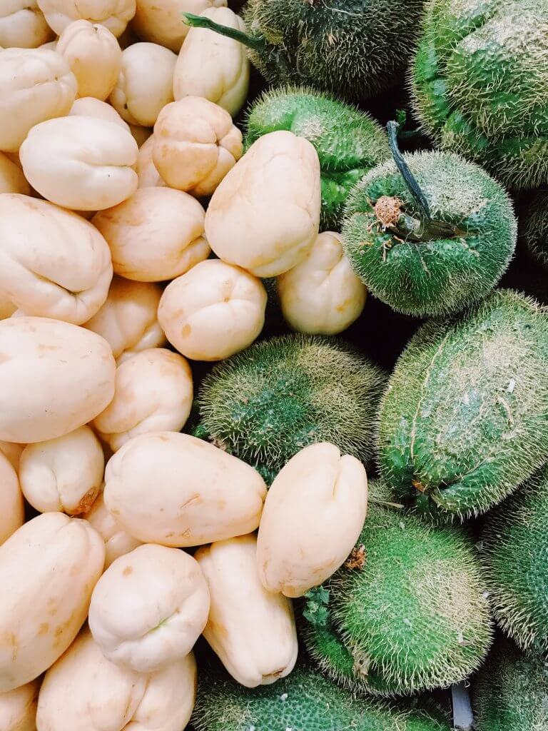 Prickly green Chayotes and white chayotes in a Mexico City market | Cooking Class in Mexico City