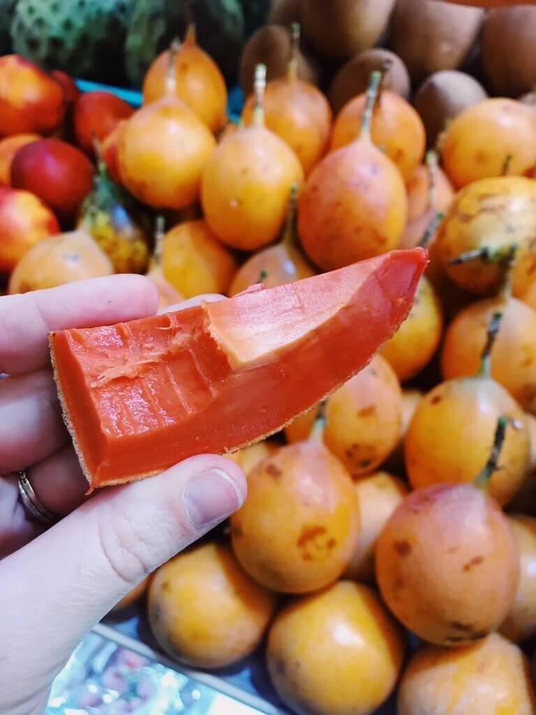 Tasting Mamey Fruit at Mercado Medellin Mexico City